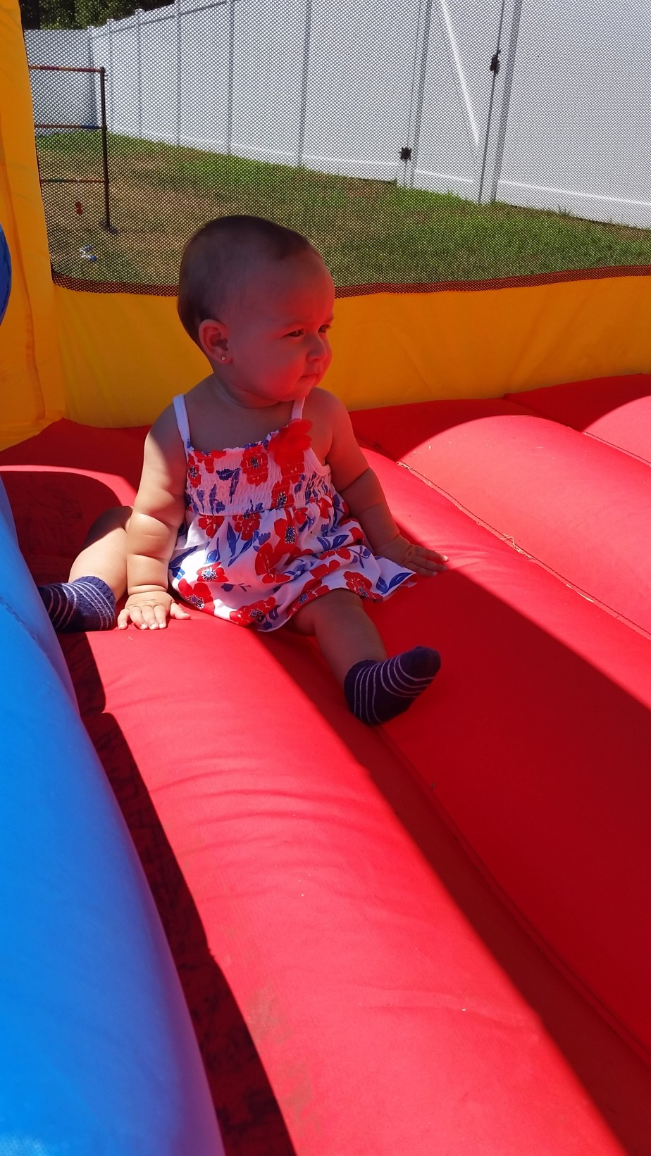 Elleanna in the bounce house.