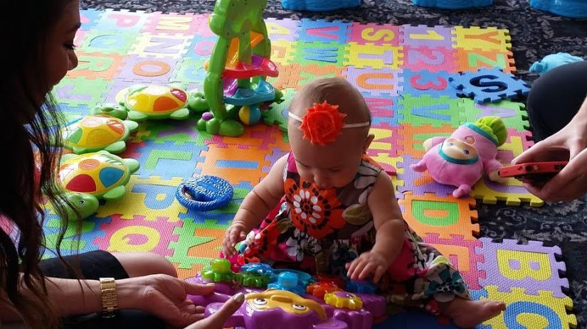 Elleanna interacting as she plays with what seemed to be her favorite toy.