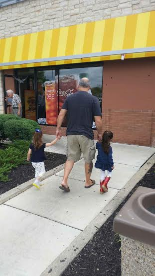 Grandpa walking the girls in to Mc Donald's.