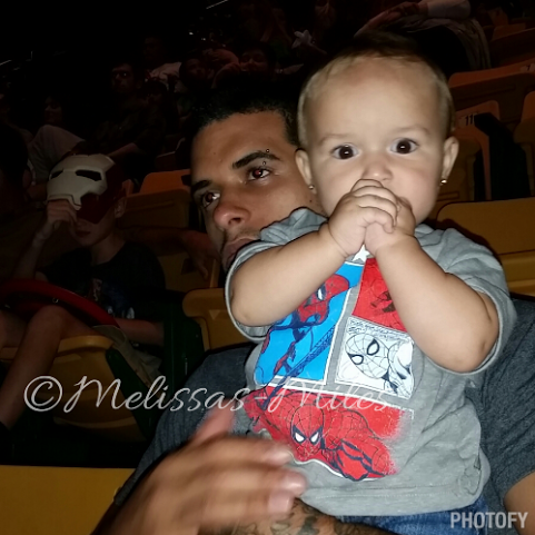 Elleanna is entranced into the show, along with daddy.